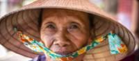Local Vietnamese woman in her 'Non la' traditional hat | Richard I'Anson