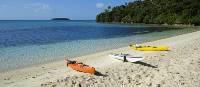 Kayaks waiting on the sand   Sherry Wooton